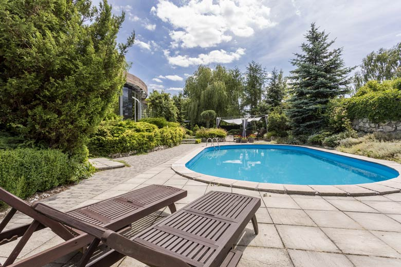 Oval Concrete Swimming Pool — Ideal Pools in Mudgeeraba, QLD